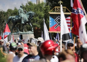 The statue of Confederate General Robert E. Lee stands behind a crowd of hundreds of white nationalists, neo-Nazis and members of the 'alt-right' in Charlottesville.