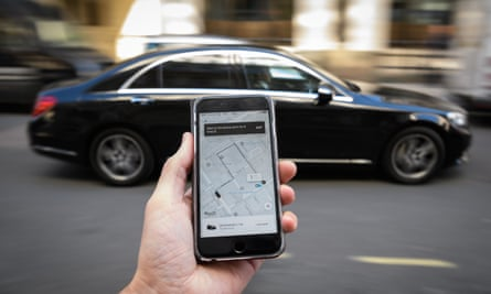 A phone displays the Uber ride-hailing app in London.