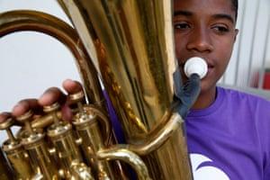 Vitor Hugo Ferreira, 14, rehearses the tenor tuba