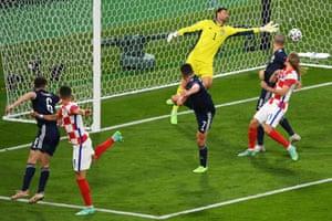 Croatia's forward Ivan Perisic (second left) scores their third goal.