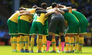 Norwich City's players form a huddle prior to their opening game against Palace in August