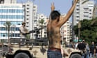 Gunfire and violence in Beirut as tensions erupt over blast investigation – video