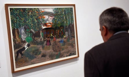 A man looks at the work 'Sad Land' exhibited at the Reina Sofia Museum in Madrid.