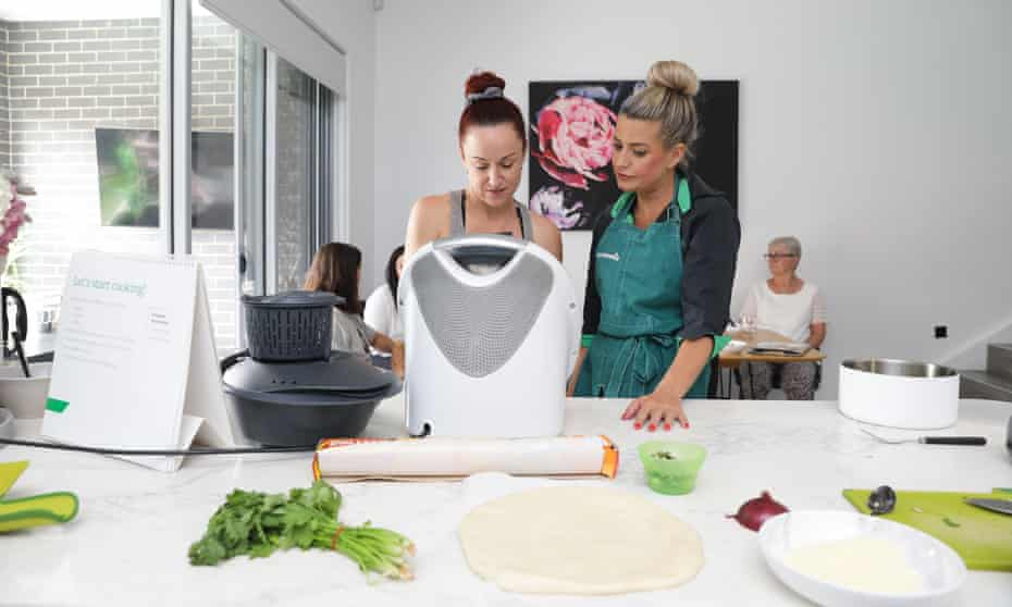 A Thermomix demonstration led by Hannah Phelps (right), a top-selling consultant, held in her kitchen in Sydney's west