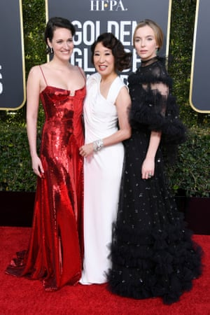 Sandra Oh wearing Versace with Killing Eve co-star Jodie Comer in Ralph & Russo and scriptwriter Phoebe Waller-Bridge wearing Galvan.