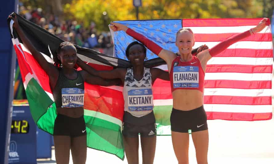 Mary Keitany (centre) celebrates her victory with Vivian Cheruiyot and Shalane Flanagan, who finished second and third respectively