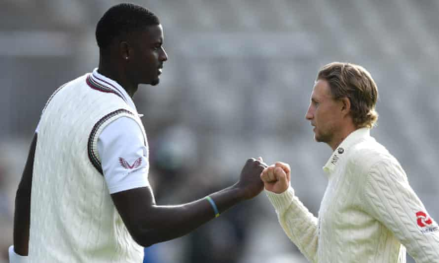 West Indies' Jason Holder and the England captain, Joe Root, fist bump during last summer's Test series.