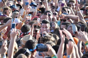 Where's Waldo? We don't know, but here is Dan Smith of Bastille attempting to liven up a moshpit
