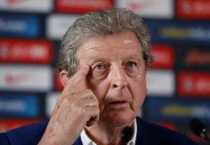 Roy Hodgson faces the media.