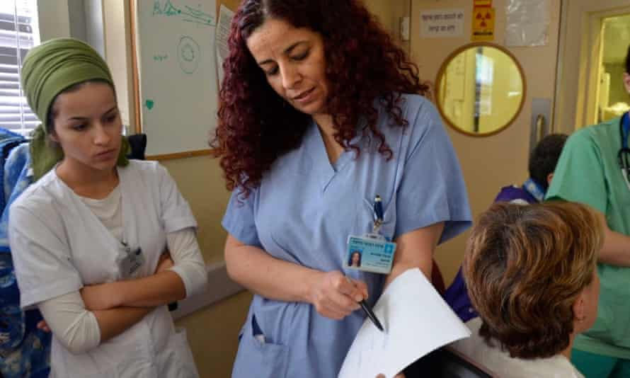 Siham Sheble Masarwa, an Israeli Arab and head technician of Hadassah Ein Kerem's catheterisation lab, teaches Jewish Israeli students