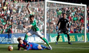 Barcelona's Denis Suarez tumbles in the box infront of Real Betis' Alin Tosca.