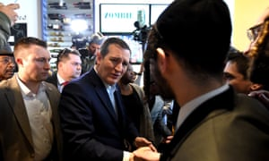 Republican presidential candidate Ted Cruz visits a restaurant in the Bronx, New York, ahead of Tuesday's primary election.