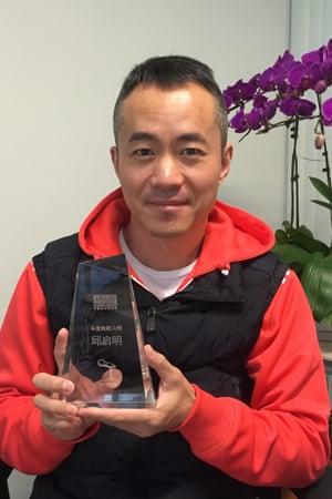 Qiu Qiming with his Rainbow Media Award