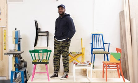 Yinka Ilori photographed last month with his chairs.
