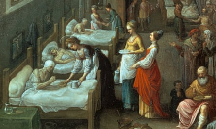 Oil painting of 16th C hospital; three beds to the left, each with a patient.  Three female figures in bright dresses, one blue, one yellow, one red, tend to the nearest patient.  An elderly man with a bandaged leg sits to the bottom right.