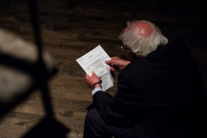 Senator Bernie Sanders reviews his notes backstage before speaking at the event.