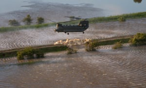 RAF Chinook helicopter over flood waters