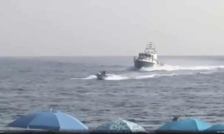 A police boat gives chase.