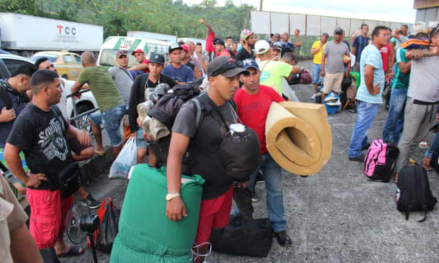 Cuban migrants wait to be housed in hotels, in Paso Canoas, Panama, on Monday.