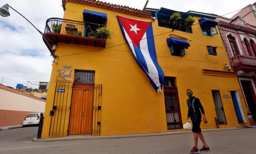 A man walks in a street in Havana, Cuba.
