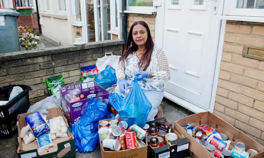 Lakmini Shah surrounded by boxes of food