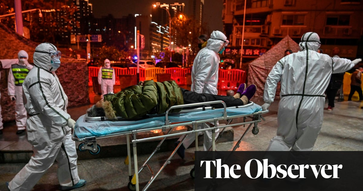 A year after Wuhan alarm, China seeks to change Covid origin story - the guardian