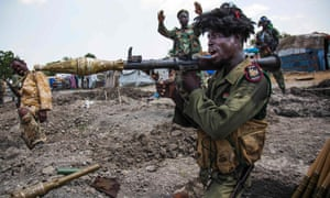 Soldiers of the Sudan People's Liberation Army in a trench in Lelo, outside Malakal, in northern South Sudan