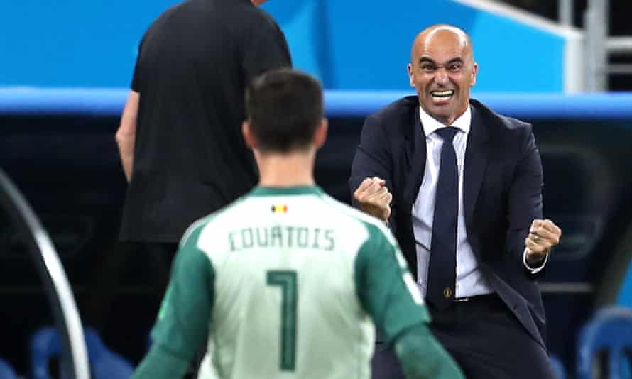 Roberto Martínez celebrates with his goalkeeper Thibaut Courtois after Belgium's late winner