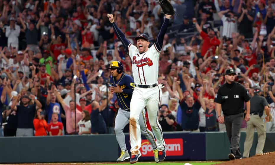 Freddie Freeman celebrates the Braves' win over the Brewers