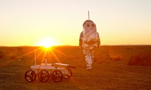 A scientist wears an Aouda Mars space suit simulator in Morocco. Mars missions are on the horizon, but it's still unclear whether humans will be able to survive them.