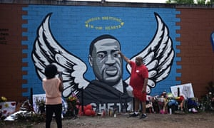 People visit a makeshift memorial for George Floyd in his former neighborhood, the Third Ward, in Houston, Texas, in June.