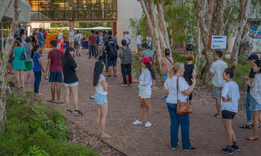 International students in Darwin queue for food hampers