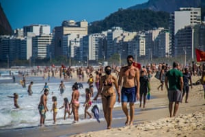 Bathers at Praia do Leme, in Rio's south zone on 2 August 2020, as social distancing rules are eased to allow bathing in the sea, while gatherings on the sand are still prohibited.