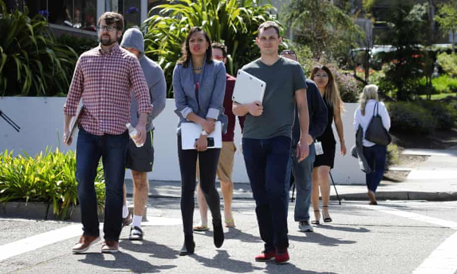 YouTube employees are seen walking away from company's headquarters after the shooting.