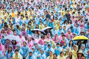 Bijie, ChinaStudents wearing raincoats attend a graduation ceremony after the 2021 National college entrance Exam at Minzu High School