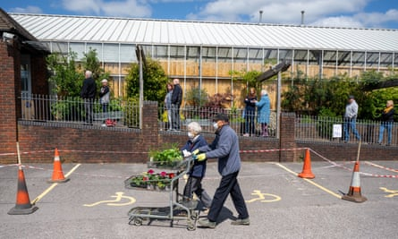 A couple, wearing face masks leave Caerphilly Garden Centre in Cardiff