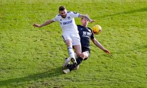 Leeds United defender Stuart Dallas gets rid of the ball.