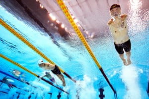 China's Tao Zheng (right) competes in the men's S5 100m freestyle heats.