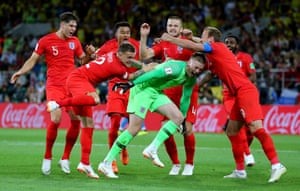 Pickford on his way to being at the bottom of the bundle as England celebrate their first World Cup penalty shoot out victory.