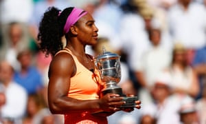 Serena Williams poses with the Coupe Suzanne Lenglen trophy after winning the 2015 French Open
