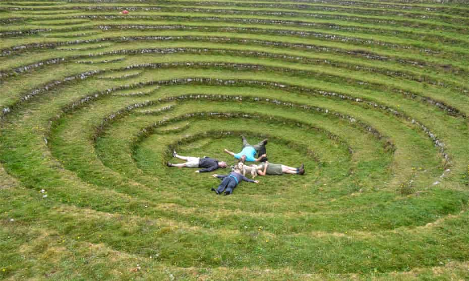 People lying on the grass of Gwennap Pit, Cornwall.
