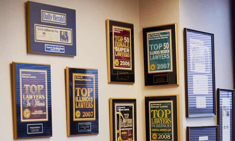Wall of fame: certificates of achievement in Kathleen Zellner's office.