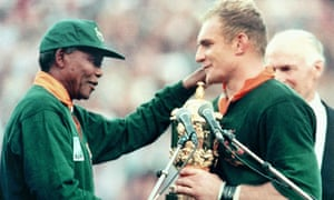 The South African president, Nelson Mandela, congratulates the Springboks skipper, Francois Pienaar, after winning 1995 World Cup.