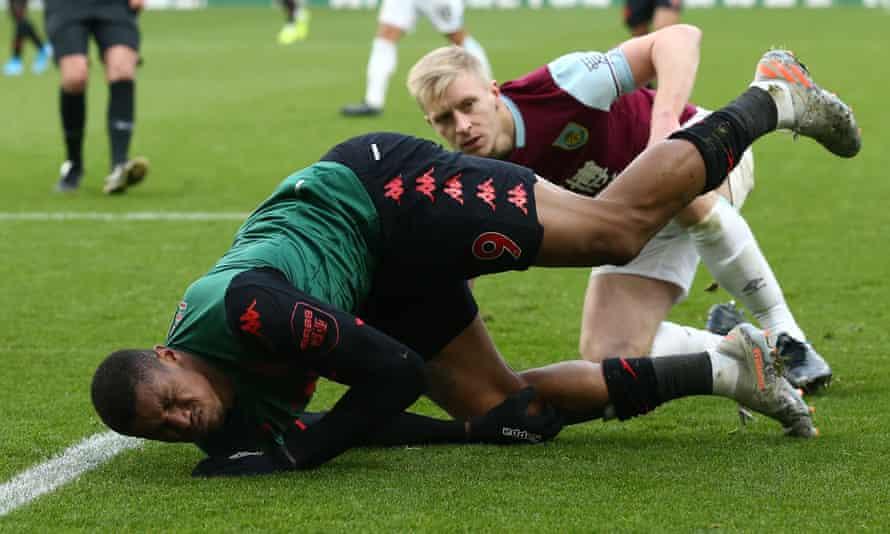 Wesley of Aston Villa suffers his knee injury at Burnley.