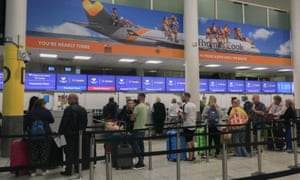 Check in counter of Thomas Cook airlines at Gatwick Airport.