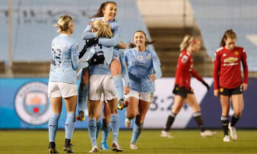 Caroline Weir is held aloft by her Manchester City teammates after scoring against Manchester United.