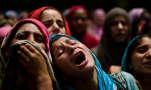 A relative of Auqib Ahmad Bhat mourns on seeing his dead body