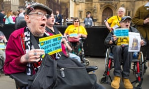 Disabled people protest at parliament about the loss of the independent living fund