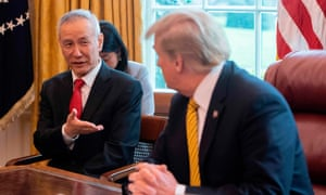 China's vice-premier, Liu He, speaks with Donald Trump during a trade meeting in the Oval Office of the White House, on 4 April.