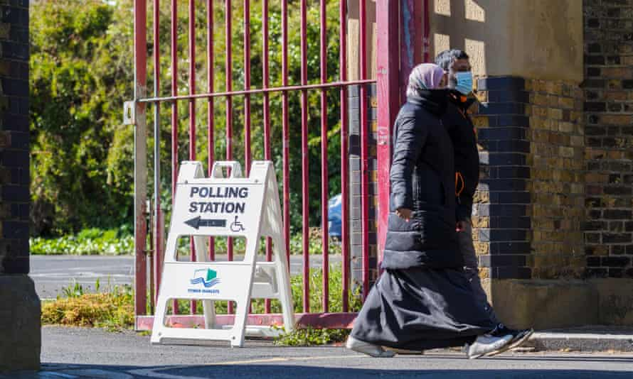 People leave a polling station in Tower Hamlets, London